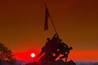 Statue of Marines holding up the American Flag at the Iwo Jima Memorial (United States Marine Corps War Memorial) at sunrise, Arlington, Virginia