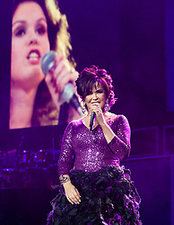 "© Licensed to London News Pictures. 20/01/2013. London, UK.   Marie Osmond of Donny and Marie Osmond performing live at The O2 Arena in front of a screen showing Marie when she was younger, on the opening night of their Donny & Marie Live tour Sunday 20 January 2013.  .Donald Clark ""Donny"" Osmond (born December 9, 1957) is an American singer, musician, actor, dancer, radio personality, and former teen idol. Donny Osmond has also been a talk and game show host, record producer and author. In the mid 1960s, he and four of his elder brothers gained fame as The Osmonds on the long running variety program, The Andy Williams Show. Donny went solo in the early 1970s covering such hits as ""Go Away Little Girl"" and ""Puppy Love""...Olive Marie Osmond (born October 13, 1959) is an American singer, actress, doll designer, and a member of the show business family The Osmonds. Although she was never part of her family's singing group, she gained success as a solo country music artist in the 1970s and 1980s. .For over thirty-five years, Donny and Marie have gained fame as Donny & Marie, partly due to the success of their 1976-79 self-titled variety series, which aired on ABC. The duo also did a 1998-2000 talk show and have been headlining in Las Vegas since 2008.   Photo credit : Richard Isaac/LNP"