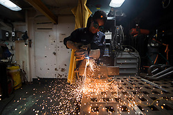 170507-N-LC424-1190 PACIFIC OCEAN (May 7, 2017) Hull Technician 3rd Class Tessa Williams, a New York native, assigned to the engineering department of amphibious dock landing ship USS Pearl Harbor (LSD 52), welds in the ship's Machine Shop. More than 1,800 Sailors and 2,600 Marines assigned to the America Amphibious Ready Group (ARG) and the 15th Marine Expeditionary Unit (MEU) are currently conducting a Composite Unit Training Exercise (COMPTUEX) off the coast of Southern California in preparation for the ARG's deployment later this year. The America ARG is comprised of Pearl Harbor, the amphibious transport dock, USS San Diego (LPD 22) and the amphibious assault ship USS America (LHA 6). (U.S. Navy photo by Mass Communication Specialist 3rd Class Tarra Samoluk/Released)170507-N-LC424-1190<br /> Join the conversation:<br /> http://www.navy.mil/viewGallery.asp<br /> http://www.facebook.com/USNavy<br /> http://www.twitter.com/USNavy<br /> http://navylive.dodlive.mil<br /> http://pinterest.com<br /> https://plus.google.com
