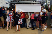 In the Olympic Park during the London 2012 Olympics, US sports fans hope to be seen on TV as members of the United States women's water polo make a TV appearance on NBC's Today show broadcast live from the Olympic Park during the London 2012 Olympics - the morning after winning the gold medal match against Spain.