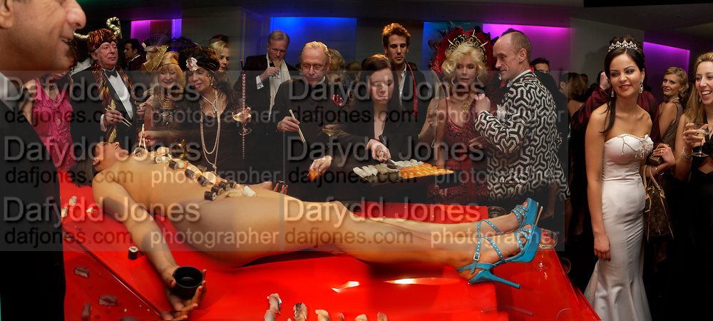 Terence Cole, Liz Brewer and Dame Shirley Bassey on left. Countess Gunilla von Bismarck and Gotfried von Bismarck, Amanda from Playtime Platter lying on the table. Andy & Patti Wong's Chinese New Year party to celebrate the year of the Rooster held at the Great Eastern Hotel, Liverpool Street, London.29th January 2005. The theme was a night of hedonism in 1920's Shanghai. .