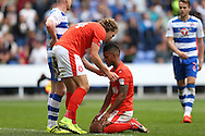Michael Hefele of Huddersfield Town lifts up Elias Kachunga of Huddersfield Town after the final whistle as they both slump dejected after losing the game. EFL Skybet  championship match, Reading  v Huddersfield Town at The Madejski Stadium in Reading, Berkshire on Saturday 24th September 2016.<br /> pic by John Patrick Fletcher, Andrew Orchard sports photography.