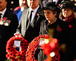 Prime Minister Theresa May lays a wreath during the remembrance service at the Cenotaph memorial in Whitehall, central London, on the 100th anniversary of the signing of the Armistice which marked the end of the First World War.