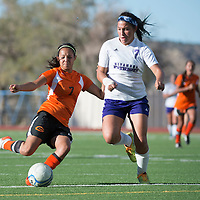 092514      Cayla Nimmo<br /> <br /> Gallup Bengal Danitza Zavala (7) and Miyamura Patriot Riley Etcitty (7) fight for possession of the ball during the game held at the Public School Stadium Thursday.