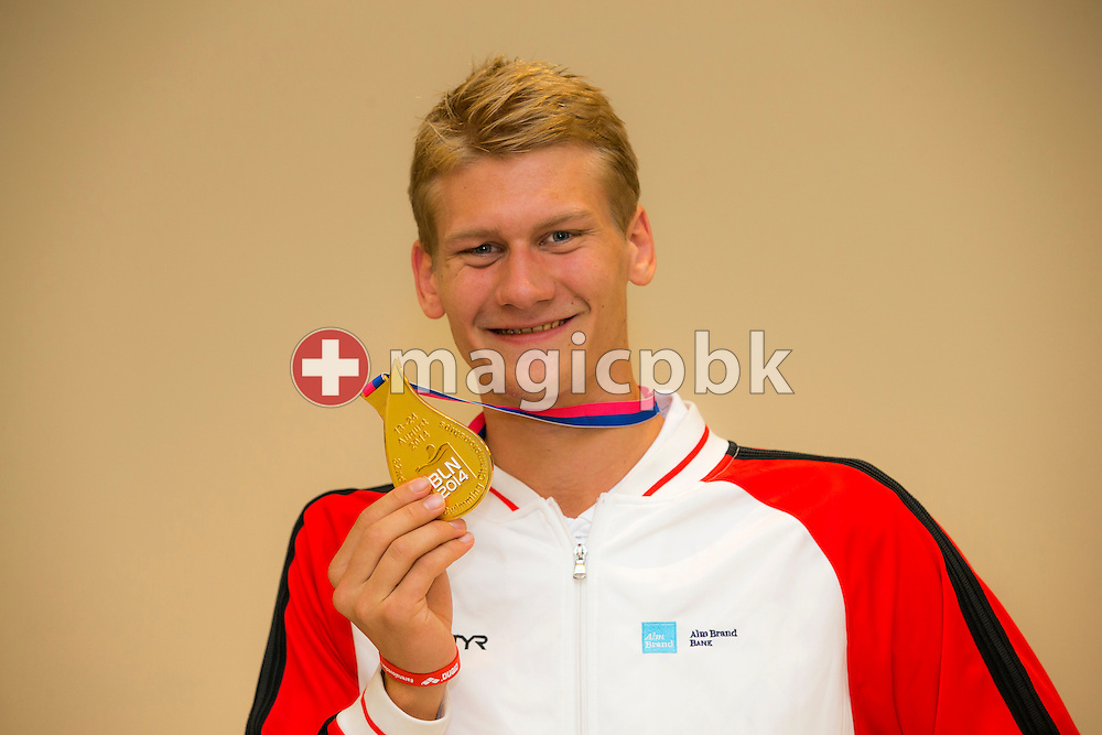 Viktor B. BROMER of Denmark poses with his gold medal after the LEN European Swimming Championships at Europa-Sportpark in Berlin, Germany, Sunday, Aug. 24, 2014. (Photo by Patrick B. Kraemer / MAGICPBK)