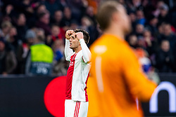 12-12-2018 NED: Champions League AFC Ajax - FC Bayern Munchen, Amsterdam<br /> Match day 6 Group E - Ajax - Bayern Munchen 3-3 / Dusan Tadic #10 of Ajax scores the 1-1 and celebrate. In the foreground Manuel Neuer #1 of Bayern Munich