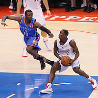 11 May 2014: Los Angeles Clippers guard Darren Collison (2) drives past Oklahoma City Thunder guard Reggie Jackson (15) during the Los Angeles Clippers 101-99 victory over the Oklahoma City Thunder, during Game Four of the Western Conference Semifinals of the NBA Playoffs, at the Staples Center, Los Angeles, California, USA.