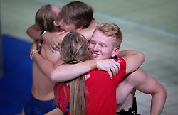 Great Britain's James Heatly (right) and Robyn Birch gives their coaches a hug prior to the start of the Mixed Team Diving Final during day five of the 2018 European Championships at the Royal Commonwealth Pool, Edinburgh.
