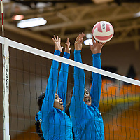 Eagles Octvia Freeland, left, and Shihaya Clark, right, work together at the net to block a Bengals point Wednesday night at Gallup High School in Gallup.