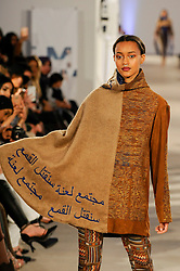 © Licensed to London News Pictures. 19/02/2017. London, UK.  A model presents a look by Za'ra Khan (UK) on the final day of the UK's first London Modest Fashion Week taking place this weekend at the Saatchi Gallery.  The two day event sees 40 brands from across the world come together to showcase their collections for Muslim and other religious women. Photo credit : Stephen Chung/LNP