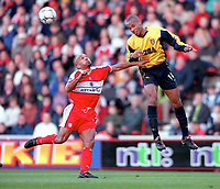 Thierry Henry (Arsenal) and Curtis Fleming (Middlesbrough). Middlesbrough 0:1 Arsenal. F.A.Carling Premiership, 4/11/2000. Credit: Colorsport / Stuart MacFarlane.