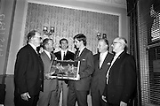 21/05/1966<br /> 05/21/1966<br /> 21 May 1966<br /> Castrol (Ireland) Ltd. presentation of Castrol Trophy to Home Farm football team at the Central Hotel, Dublin. Replicas were presented to each of the players and Drumcondra, who were runners-up received medals. Picture shows Mr. Leonard A. Courtney, Managing Director of Castrol (Ireland) Ltd. (2nd left) presenting the Castrol Trophy to Jerry James, Captain of Home Farm. Also in the picture are (l-r): Mr. R.J. Doram, Honorary Treasurer, F.A.I.; P. McGrath, Captain Drumcondra team; Mr. Brendan Menton, Honorary Secretary, Home Farm and Mr. C. Darbey, Honorary Secretary, Football League of Ireland.