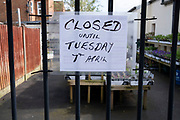 Local response to Coronavirus is felt on a street by street level as signs in small shops and businesses, like this garden centre announce that they are closed for business until restrictions are lifted on 6th April 2020 in Birmingham, England, United Kingdom. Coronavirus or Covid-19 is a new respiratory illness that has not previously been seen in humans. While much or Europe has been placed into lockdown, the UK government has announced more stringent rules as part of their long term strategy, and in particular social distancing.