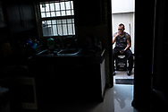 Deported U.S. Marine Corps veteran Michael Hugo Evans, 40, smokes in the backyard of his apartment in Ciudad Juárez, Chihuahua, México, Wednesday, July 25, 2018.<br /> <br /> Evans was adopted by an American family in 1984. He enlisted in the Marines as a green card holder in 1996 and was honorably discharged in 2000. During his military service, he was stationed in Camp Pendleton, California and was part of the first class to go through the Crucible, the final stage of a Marine recruit's training which includes food and sleep deprivation in addition to over 45 miles of marching during a 54-hour field exercise. In 2009, Evans was deported to México after completing a 52-month sentence for conspiracy to distribute narcotics.
