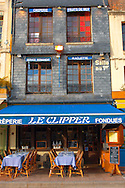 Harbour side restauarant - The Clipper. Honfleur, Normandy, France. . Honfleur is especially known for its old port, characterised by its houses with slate-covered frontages, painted many times by artists, including in particular Gustave Courbet, Eugène Boudin, Claude Monet and Johan Jongkind, forming the école de Honfleur (Honfleur school) which contributed to the appearance of the Impressionist movement. .<br /> <br /> Visit our FRANCE HISTORIC PLACES PHOTO COLLECTIONS for more photos to download or buy as wall art prints https://funkystock.photoshelter.com/gallery-collection/Pictures-Images-of-France-Photos-of-French-Historic-Landmark-Sites/C0000pDRcOaIqj8E