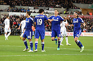 Diego Costa of Chelsea (19) celebrates with his teammates after he scores his teams 2nd goal.Barclays Premier League match, Swansea city v Chelsea at the Liberty Stadium in Swansea, South Wales on Saturday 17th Jan 2015.<br /> pic by Andrew Orchard, Andrew Orchard sports photography.