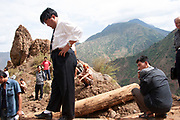 A government official comes to inspect a landslide being cleared in the Mian Mian Shan mountains. There are constant landslides in this area as the mountains crumble in the rain. It is common to see roads blocked and large rocks falling down the mountains. Low paid workers are on call to clear the rocks to earn a few Reminbi (Yuan).