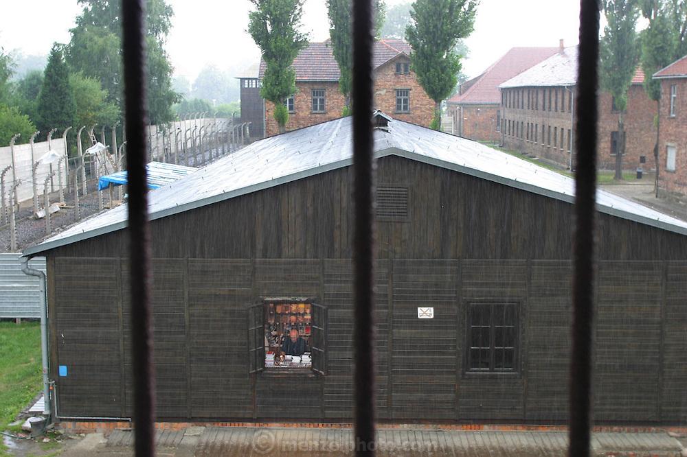 Auschwitz Death Camp, Poland, souvenirs for sale, rainstorm.