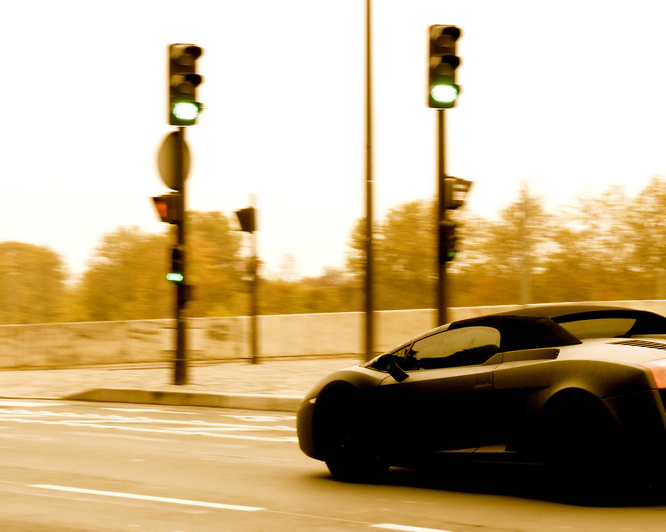 Waiting to cross the street in Paris one afternoon I heard the approach of an Italian, sports car that is.  This mat black Lamborghini swept by gracefully.