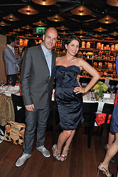 SADIE FROST and JONNY LEE MILLER at a dinner to celebrate the beginning of a unique partnership between The Naked Heart Foundation and W's Newest Hotel W St.Petersburg -The 'For Russia With Love' dinner was hosted by Sadie Frost and Natalia Vodianova at Spice Market restaurant, W London, Leicester Square, London on 2nd June 2011.