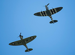 © Licensed to London News Pictures. 10/07/2020. London, UK. A hurricane and a Spitfire plane take part in a flypast over the town of Ditchling, East Sussex, ahead of the funeral of Dame Vera Lynn. The 'Forces' Sweetheart', who died last month aged 103, was famous for singing performances during WW2, which helped raise morale amongst troops abroad. Photo credit: Ben Cawthra/LNP