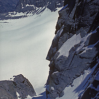 Jan Mark Baker skis the first descent of Clyde's Couloir on North Palisade Peak above above the Palisade Glacier in California's Sierra Nevada,