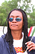 Cinco de Mayo Festival participant age 29 holding Mexican flag.  St Paul Minnesota USA