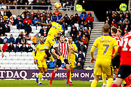Wimbledon defender Adedeji Oshilaja (4) clears the danger  during the EFL Sky Bet League 1 match between Sunderland and AFC Wimbledon at the Stadium Of Light, Sunderland, England on 2 February 2019.