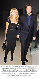 Actor LIAM NEESON and NATASHA RICHARDSON, at a party in London on 5th September 2002.PCZ 53
