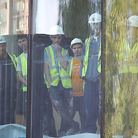 From an overlooking building onto Leicester Square, a group of construction workers observe the red carpet arrival of Angelina Jolie for the 'Salt,' premiere, August  16, 2010, at the Empire, in London..