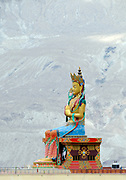 Statue of Jampa (Maitreya) Buddha, the future Buddha reported to be 32 metres, 106 feet, tall. The statue was built between 2006 and 2010 and was paid for by public subscription. The statue is below Diskit Monastery, Deskit Gompa, Diskit Gompa on the mountain side above the  Shyok valley in the north east of Ladakh. Diskit, Ladakh, Republic of India. 15Sep11