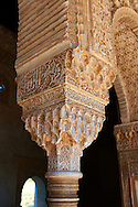 """Moorish pillars and capitals in the inner courtyard  of the Palacios Nazaries,  Alhambra. Granada, Andalusia, Spain. . The Alhambra is a palace and fortress complex located in Granada, Andalusia, Spain. It was originally constructed as a small fortress in 889 CE on the remains of ancient Roman fortifications. The Alhambra was renovated and rebuilt in the mid-13th century by the Arab Nasrid emir Mohammed ben Al-Ahmar of the Emirate of Granada, who built its current Alhambra palace and walls. The Alhambra was converted into a royal palace in 1333 by Yusuf I, Sultan of Granada. The decoration of The Alhambra consists for the upper part of the walls, as a rule, of Arabic inscriptions—mostly poems by Ibn Zamrak and others praising the palace—that are manipulated into geometrical patterns with vegetal background set onto an arabesque setting (""""Ataurique""""). Much of this ornament is carved stucco (plaster) rather than stone. Tile mosaics (""""alicatado"""") of The Alhambra, with complicated mathematical patterns (""""tracería"""", most precisely """"lacería""""), are largely used as panelling for the lower part. .<br /> <br /> Visit our SPAIN HISTORIC PLACXES PHOTO COLLECTIONS for more photos to download or buy as wall art prints https://funkystock.photoshelter.com/gallery-collection/Pictures-Images-of-Spain-Spanish-Historical-Archaeology-Sites-Museum-Antiquities/C0000EUVhLC3Nbgw <br /> .<br /> Visit our ISLAMIC HISTORICAL PLACES PHOTO COLLECTIONS for more photos to download or buy as wall art prints https://funkystock.photoshelter.com/gallery-collection/Islam-Islamic-Historic-Places-Architecture-Pictures-Images-of/C0000n7SGOHt9XWI"""