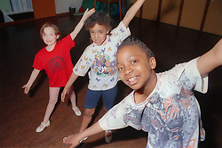 Multiracial group of children performing gymnastic routine,
