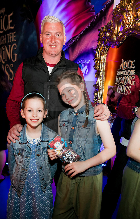 Repro Free: 24/05/2016 Colin Woodfull with daughters Ciara (8) and Aoife (11) pictured at the exclusive gala screening of Disney's ALICE THROUGH THE LOOKING GLASS, an all-new spectacular adventure featuring the unforgettable characters from Lewis Carroll's beloved stories. Disney's ALICE THROUGH THE LOOKING GLASS opens in Irish cinemas on May 27, 2016. Picture Andres Poveda