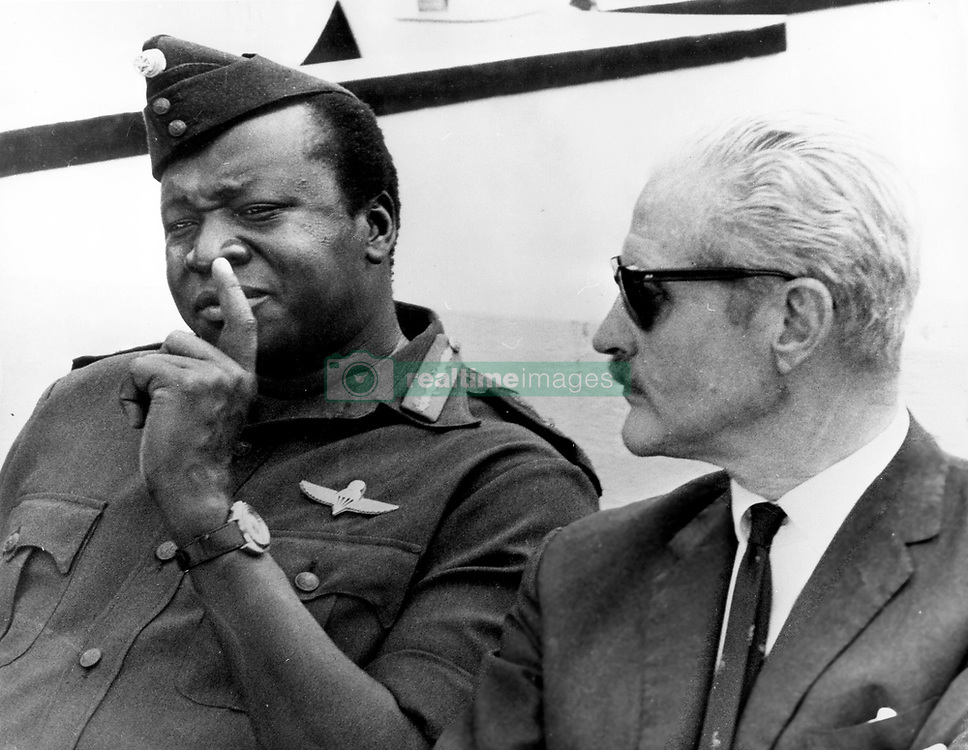 Oct 16, 1972; Kampala, Uganda; General IDI AMIN told Mr. RICHARD SLATER, Britain's High Commissioner, to get out of Uganda as soon as the last batch of Asians leave. He accused Mr. Slater of unfounded reports to the British press. Mr. Slater has been told by Sir Alec Douglas Home, the Foreign Secretary, to return to London to make a full report. The picture shows President Amin pictured with Mr. Slater (R). (Credit Image: © Keystone Press Agency/Keystone USA via ZUMAPRESS.com)