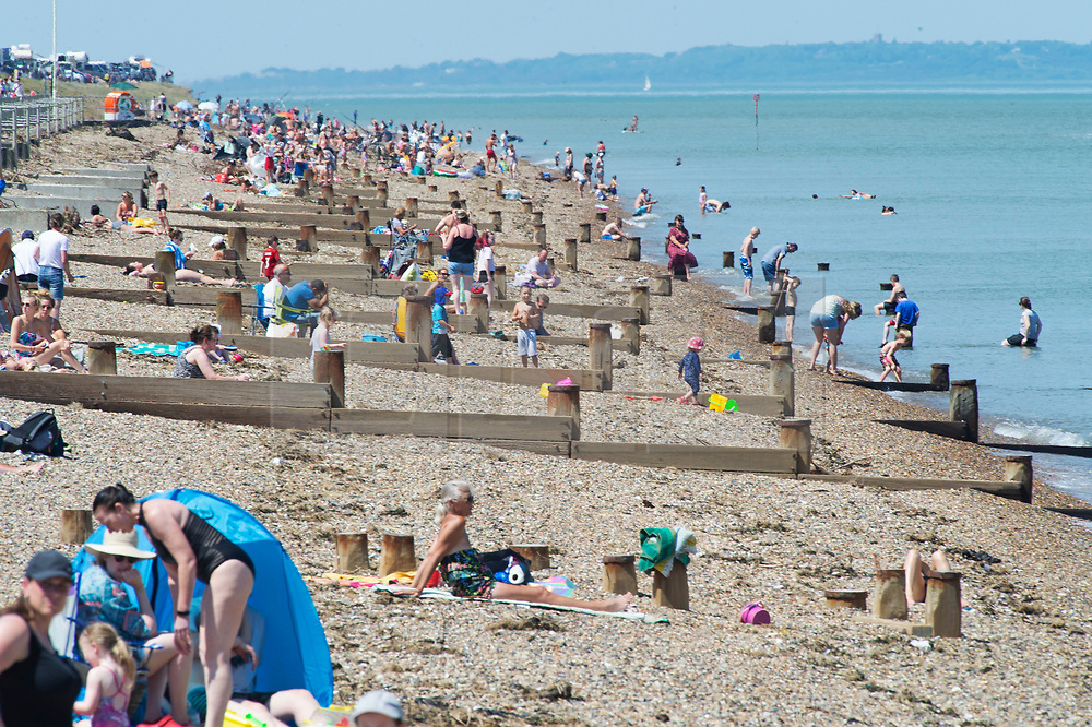 ©Licensed to London News Pictures 20/05/2020  <br /> Minster on sea, UK. Hundreds of sunseekers on the beach. People enjoying their lockdown freedom with a day by the sea at Minster-on-sea on the Isle of Sheppey in Kent. Today is expected to be the hottest day of the year with temperatures in the South East of the UK to hit around 29C. Photo credit:Grant Falvey/LNP