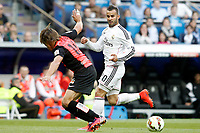 Real Madrid's Jese Rodriguez (r) and Almeria's Sebastian Dubarbier during La Liga match. April 29,2015. (ALTERPHOTOS/Acero)
