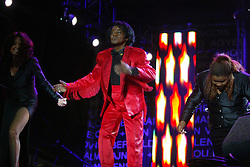 James Brown leaving the stage..50,000 people filed into Murrayfield Stadium in Edinburgh, Scotland, on Wednesday July 6, 2005. The free gig, labelled Edinburgh 50,000 - The Final Push was the last of Bob Geldof's momentous Live 8 concerts..Pic ©2010 Michael Schofield. All Rights Reserved.