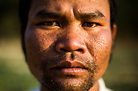 A portrait of Touneh Du, a Chu Ru ethnic minority farmer, and recipient of PES funds in Lam Dong province, Vietnam.