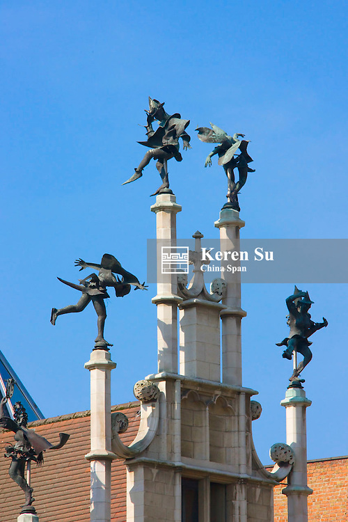 The facade of a Workman's Houses, 16th-century building, with six dancing devils at the top created by the Ghent sculptor and folk-singer walter De Buck, the initiator of the Ghent Festivities, the building now houses the East Fladers Tourist Office, Ghent, Brussels, Belgium