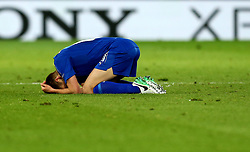 Marc Albrighton of Leicester City curls up on the floor in dejection after the defeat to Atletico Madrid in the UEFA Champions League Quarter-Final - Mandatory by-line: Robbie Stephenson/JMP - 18/04/2017 - FOOTBALL - King Power Stadium - Leicester, England - Leicester City v Atletico Madrid - UEFA Champions League Quarter-Final Second Leg