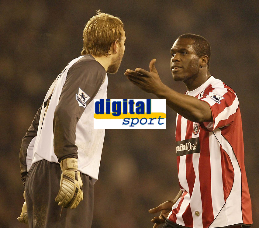 Photo: Aidan Ellis.<br /> Sheffield United v Manchester City. The Barclays Premiership. 26/12/2006.<br /> City keepr Nicky Weaver argues with Sheffield's Christian Nade