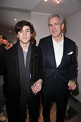 Left to right, JONAH KING and his father JEREMY KING at the launch party for Club Monaco at Browns, 32 South Molton Street, London on 16th February 2011.