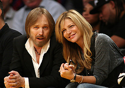 October 2, 2017 - Los Angeles, California, U.S - Monday, October 2, 2017. Tom Petty on life support at UCLA Medical Center Santa Monica after apparent heart attack in his Malibu, California home. FILE PHOTO: Tom Petty and his wife Dana York at the   Los Angeles Clippers and the Los Angeles Lakers at Staples Center on Friday, February 25, 2011 in Los Angeles,   California. (Credit Image: © Prensa Internacional via ZUMA Wire)