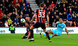 Newcastle United's Salomon Rondon (right) has a shot deflected by AFC Bournemouth's Nathan Ake (left) during the Premier League match at the Vitality Stadium, Bournemouth.