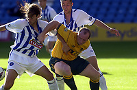 Kilmarnock v Celtic, Scottish Premier league, Rugby Park, Kilmarnock.<br />Pic Ian Stewart, Saturday 4th August 2001.<br />Hartson battles with Hessey and Dindeleux