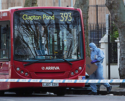 ©  London News Pictures. London, UK. File pic dated 23/04/2013. Forensics examine the 393 bus on Highbury New Park, north London where teenager Derek Boateng was stabbed to death on his 16th birthday. A teenager has today, 8 November 2013, been convicted of the murder of Derek Boateng at the Old Bailey.  Photo credit: Tolga Akmen/LNP