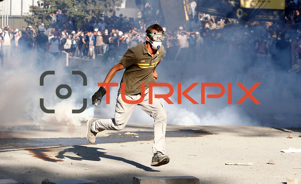 A protester throws a teargas cannister back at the riot police during a protest at Taksim Square in Istanbul June 11, 2013. Turkish riot police fired tear gas and water cannon at hundreds of protesters armed with rocks and fireworks on Tuesday as they tried to take back control of a central Istanbul square at the heart of fierce anti-government demonstrations. Photo by AYKUT AKICI/TURKPIX