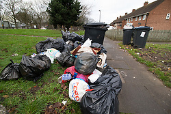 © Licensed to London News Pictures. 15/01/2019. Birmingham, West Midlands UK. Pictured, piles of rubbish in Perrins Grove, Alum Rock. The Birmingham Bin Strike enters a third week and large piles of uncollected rubbish are starting to appear on the streets of inner City Birmingham. The Refuse collectors took strike action in 2018 and forced a change of Council Leadership. Residents have complained of seeing rats and white worms outside their houses. Photo credit: Dave Warren/LNP