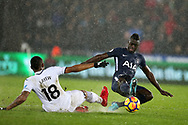Davinson Sanchez of Tottenham Hotspur ® tackles Jordan Ayew of Swansea city. Premier league match, Swansea city v Tottenham Hotspur at the Liberty Stadium in Swansea, South Wales on Tuesday 2nd January 2018. <br /> pic by  Andrew Orchard, Andrew Orchard sports photography.